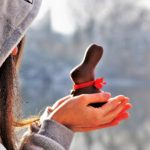 Girl holding chocolate bunny