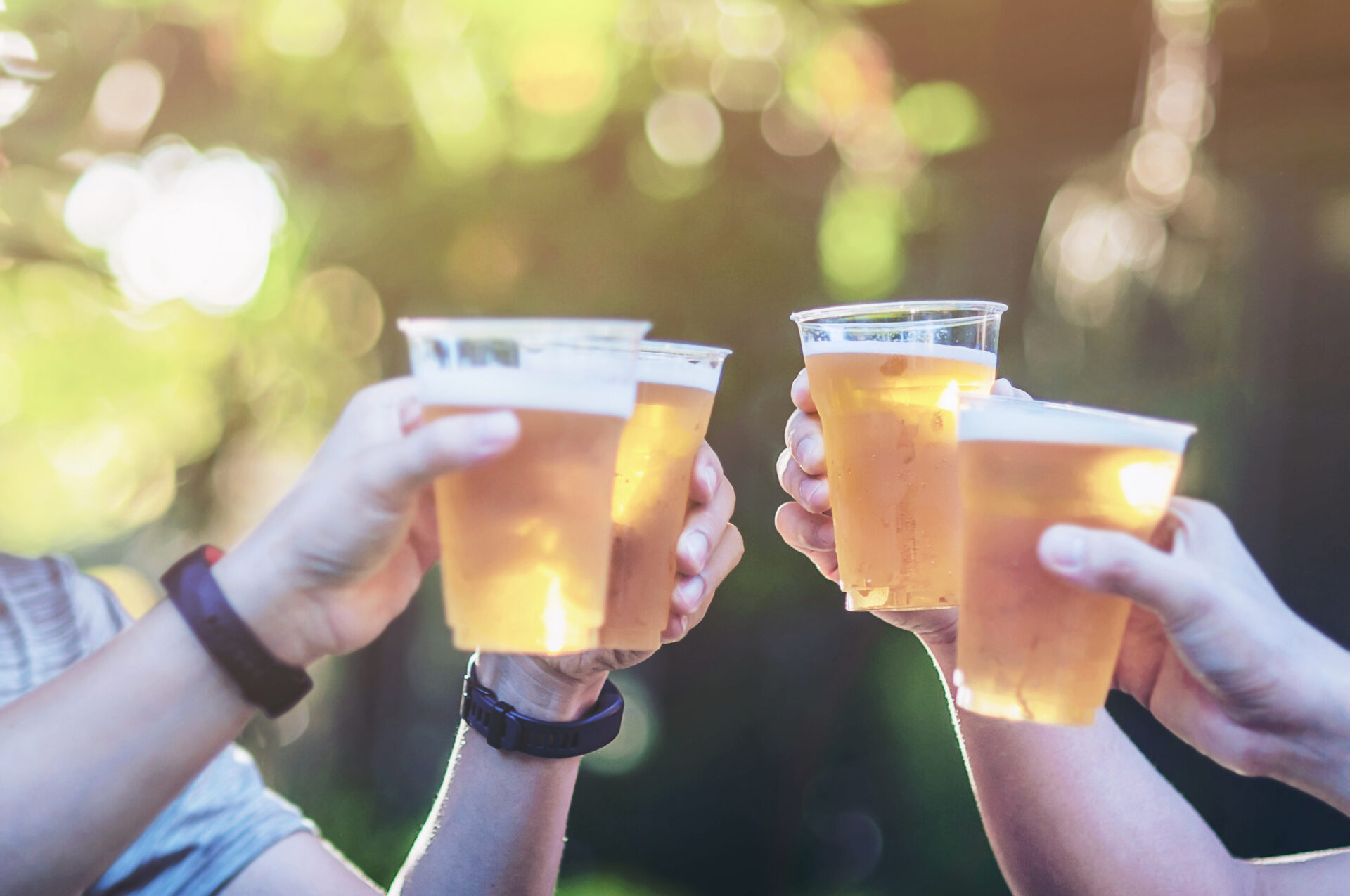 Celebration,Beer,Cheers,Concept,-,Close,Up,Hands,Holding,Up